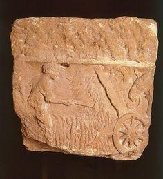 Vallus    Le vallus, ou « moissonneuse des Trévires », ancêtre de la moissonneuse mécanique, inventé par les gaulois il y a 2000 ans. Bas-relief découvert en Belgique. (Musée Gaumais, Vitron.)