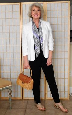 The easy casual look above could be worn in mild weather. I added a white linen jacket and a light color scarf and flat sandals. The rattan and leather-trimmed bag has the same style attitude and is appropriate for summer. – SusanAfter60.com