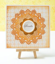 Simple card in orange colours. Background patterned paper from Sizzix (free spring papers collection)