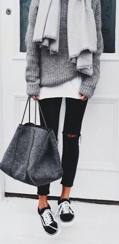 Big beautiful layers. White tunic length shirt with medium gray ribbed slouchy shorter sweater worn over it. Huge light gray fringed scarf. Worn with cropped distressed black skinny jeans. Black sneakers, remarkably large dark gray felted tote. Stye Planet