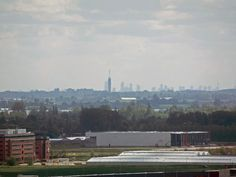 Rotterdam skyline seen from Amsterdam Schiphol control tower. 50km distance, very clear skies.
