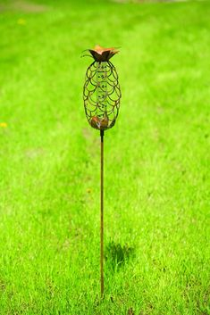 Flamed Pineapple Rain Gauge Stake. Ensure your garden is getting enough water from natural rainfall using this gauge that also adds a decorative touch.