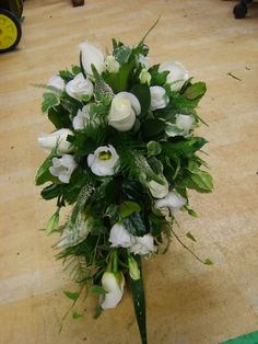 roses, lisianthus and foliage shower bouquet   www.weddingflowersbylaura.com