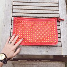 Coral and yellow clutch Add a bright color pop to any outfit! This adorable clutch is the perfect size for your wallet, phone, mints, and makeup compact. There are some slight ink stains on the inside ONLY from a rogue pen, which has been considered in the price. Forever 21 Bags Clutches & Wristlets