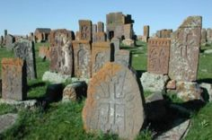 """Armenian khachkars, meaning """"cross-stones,"""" in Noratus Cemetery.  There are over 800 khachkars (stone crosses) in the territory of the cemetery, carved between the IX-XVII centuries.  This field with Khachkars', in Noratus is the second largest after the historical cemetery at Jugha (Nakhichevan) with around 2,500 khachkars, which were systematically destroyed by Azerbaijan from 1998-2005."""