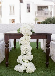 Photo by Leslee Mitchell. Rosemary Beach Wedding, white hydrangea floral table runner, wood tables, Events by Nouveau, wedding reception tables. Wedding Reception Tables, Wedding Centerpieces, Wedding Decorations, Centrepieces, Floral Centerpieces, Garland Wedding, Wedding Flowers, Wedding Bells, Rosemary Beach