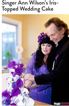 Ann Wilson and Dean Wetter cutting their Iris topped wedding cake! 64 years young looks awesome on them both!