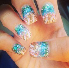 Perfect summer nails-mermaid inspired! Acrylics with multicolored crushed sea shells. Original creation by Lorenz Medina at Envi Nail Salon in Cincinnati, Ohio