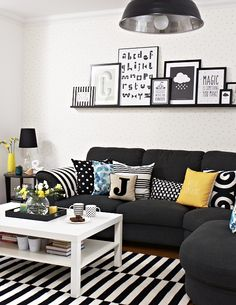 Monochrome lounge, Ikea sofa, rug and table. Industrial lights. PIcture ledge, by Interior Therapy.