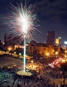 Mideast, Egypt  Celebratory fireworks explode above crowds next to the Egyptian Museum near Tahrir Square in downtown Cairo, Egypt on Feb. 12, 2011