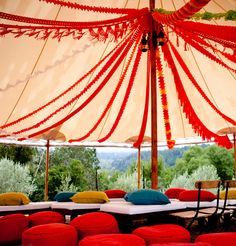 wouldn't this be a fun laid back reception area under a tent in mom and dad's back yard!!  pillows to sit on, yarn and party store streamers!