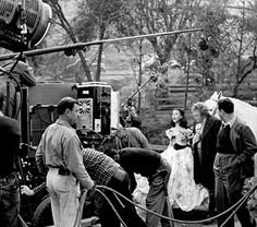 Filmmaker George Cukor didn't last long shooting Gone with the Wind before he was replaced with Victor Fleming. In this rare behind the scenes still we see George Cukor in action during this brief stint directing Vivien Leigh in a scene.