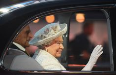 The Queen and Prince Philip are driven into the stadium to the delight of the stadium crowd.
