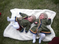 Viking wrap coats on twin baby girls with homemade hats and inkel trim