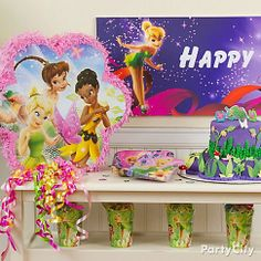It's your little pixie's b-day: time to get creative! A pinata, favor cups and a custom birthday cake on a side table = a magical sight!