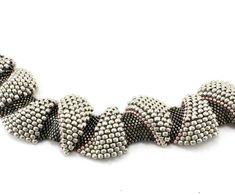 Make this fun bracelet using a peyote pattern and 3 different sized beads for a real wavy look. Finished Length: 7.5 in Skill Level: Novice Technique: Odd Count