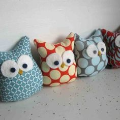 owlie pillows :D Cut out pattern of owl in two peices of fabric, turn cut peices inside out (patterns facing eachother) and sew together along edges - leave 3 in hole on side for putting in filling (cotton), reach in and turn sewed owl right-side out (patterns facing opposite) - fill with cotton (at local crafts store) and sew opening closed..  Looooove.this!