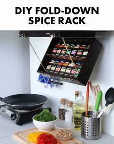 Save valuable cabinet space with this easy DIY fold-down spice rack.