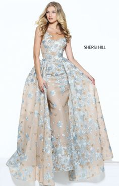 2c5739dceea7 This full-length Sherri Hill 50837 sleeveless fitted prom dress is  embellished with floral appliques and features an illusion scoop neckline.