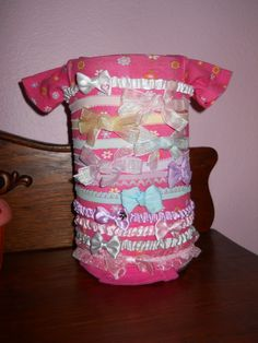 """Pinner said """"My sister Made this .Baby formula can and a onesie"""""""