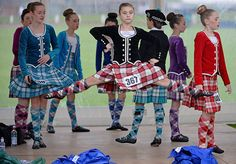 Credit: Jeff J Mitchell/Getty Images Dancers warm up before competing in the Scottish Dancing rounds