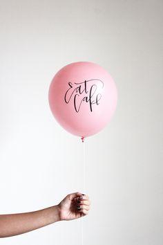 Calligraphy EAT CAKE balloons