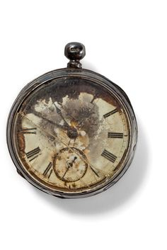A gentleman's pocket watch in a sterling silver case may have been set to New York time in anticipation of a safe arrival.