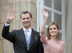 Spain's King Felipe VI (L) and Queen Letizia wave during celebrations for St James' Day in Santiago de Compostela July 25, 2014
