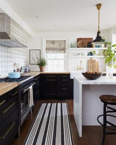 Black white wood kitchen Waterfall countertop