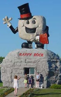 The Happy Rock, Gladstone, Manitoba. Gladstone's town monument acts as the symbol and mascot of the town. On July 5, 2010, Canada Post made a commemorative stamp of the Happy Rock as part of its Roadside Attractions collection.