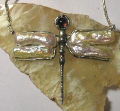 Pearl and garnet dragonfly silver pendant, by laurieopal.