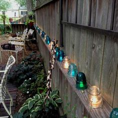 The Best 21 DIY Lighting Ideas for Summer Patio and Yard Decorate the garden fence with glass insulators that are lit underneath with a string of solar powered LEDs.