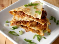 Chile Colorado Quesadillas - These are made as leftovers from another recipe (Chile Colorado) but they're easy and ridiculously delicious!  Definitely a pair of keeper recipes!