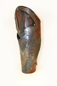 Retrofuturistic greave. LARP armor.  1.5 mm steel and leather.