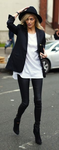Simplistic street style: lack outfit with blazer jacket, leather pants and low boots. White shirt for the contrast and accessorized with clutch and hat