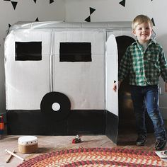 Make a mini camper playhouse for your little ones out of a few cardboard boxes!