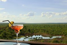 Join us for a cosmopolitan by the poolside and soak up the sun at Victoria Falls Safari Lodge