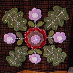 hi friends,right now my favourite material is wool.the flower blocks are my version of the caswell carpet,there will...