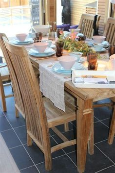 Recycled teak dining table and chairs.