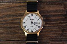 "Vintage soviet mechanical watches ''Slava"" 26 jewels, mechanical watch, men wristwatch, gold watch, white watches, Ussr watch, mens watch Vintage soviet mechanical watches ''Slava"" 26 jewels For sale is Vintage Soviet Russian Men's Wristwatch ''Slava"" 26 jewels. Year: 80s"