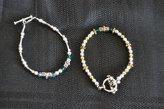 Intitial and birthstone bracelets.  Can be crafted in sterling and gold beads with sterling closures for constant wear.  Can also be crafted using non precious metal beads for occasional wear.  Pricing depends on specifications, number of initials, and crystal content.  Great for moms, grandmothers, and little girls.  PERFECT GIFTS!  Inquire for prices!