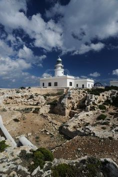 Landscape with a lighthouse on the cliff Islas Baleares