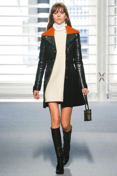 Louis Vuitton Fall 2014 Ready-to-Wear. Only Raf Simons' debut at Dior was as breathlessly anticipated as Ghesquière's at Vuitton. They're the jewels in Bernard Arnault's LVMH crown, and Arnault was in the front row today, seated alongside Princess Charlene of Monaco and other lights from the worlds of film and fashion. As curious as the rest to see what the new LV, after fourteen years of Marc Jacobs at the helm, would look like.