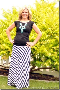 Long Black/White Stripe Maxi with turquoise bubble statement necklace.
