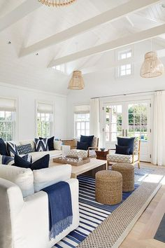 White And Blue Cottage Living Room Features Slipcovered Sofas Adorned With Pillows