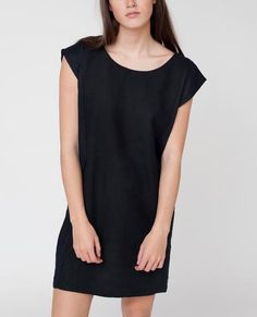 Beaumont Organic Black Lizzy Dress: Designed by British premium organic fashion label Beaumont Organic, the Lizzy Reversible Dress is a must have in any eco-conscious shopper's wardrobe! Buy less and switch up the neckline to suit your mood - either androgynous with the V neck style or soft and girly with a scoop neckline. Made ethically in England.