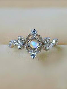 Has a mesmerizing and unique Fairytale appeal - reminds me of Cinderella  #xoKxo ~Kisxbliss  antique art deco moonstone silver engagement ring for her from jewelsin.com