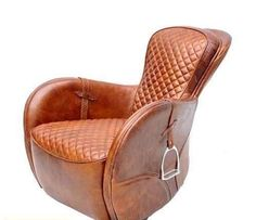 Quite a clever idea, recycling an old saddle into a comfy arm chair.