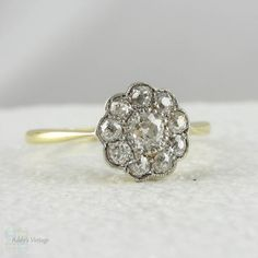 Art Deco Diamond Daisy Engagement Ring. Old Mine Cut Diamonds in Cluster Flower Shape Ring, Set in Platinum & Yellow Gold, Circa 1920s.
