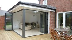 Extension with bifold doors and roof light Building Extension, House Extension Design, Roof Extension, Glass Extension, House Design, Extension Google, Extension Ideas, Bifold Doors Extension, Garage Design